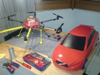 hexacopter next to volvo