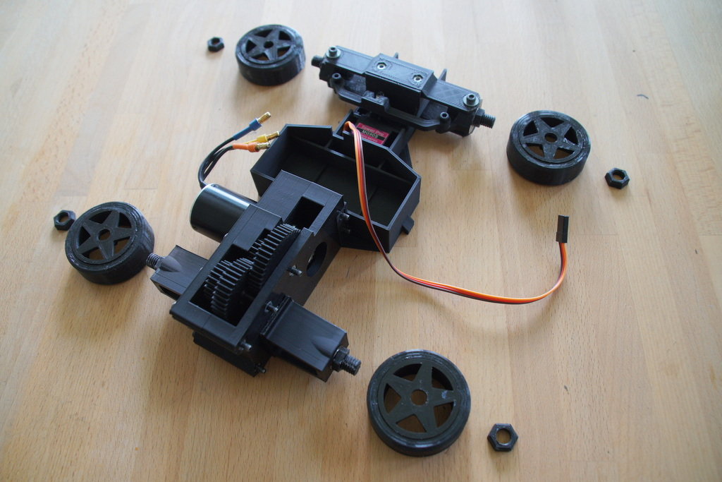 step 13, bolt wheels to chassis